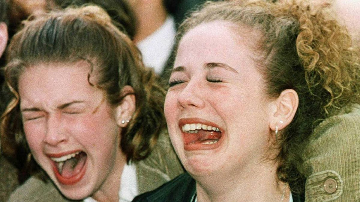 Girls scream as Prince William and Prince Harry walk into Canada Place on March 24, 1998, in Vancouver.