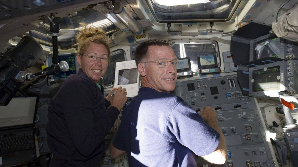 Space shuttle Atlantis Commander Chris Ferguson (R) and mission specialist Sandy Magnus are pictured on the aft flight deck of the orbiter during the mission's second day of activities in Earth orbit in this photo provided by NASA and taken July 9, 2011.