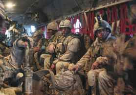 Canadian soldiers who survived a Chinook crash in Panjwaii district in southern Afghanistan return to base on another Chinook on Monday.