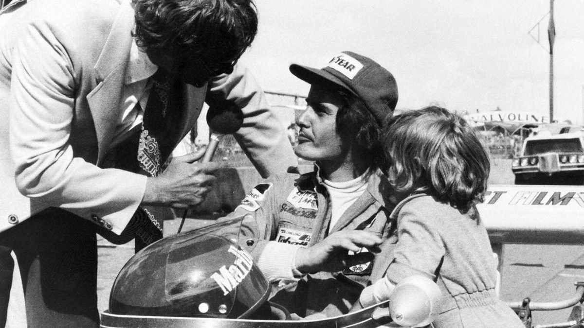 A 1974 photo shows Gilles Villeneuve being interviewed in his car as his son Jacques stands by.