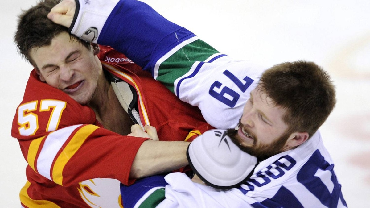 Vancouver Canucks' Mike Duco, right, fights with Calgary Flames' Lance Bouma during first period NHL action, in Calgary, Alta., Saturday, Feb. 11, 2012. The Flames won 3-2 in a shootout. THE CANADIAN PRESS/Larry MacDougal