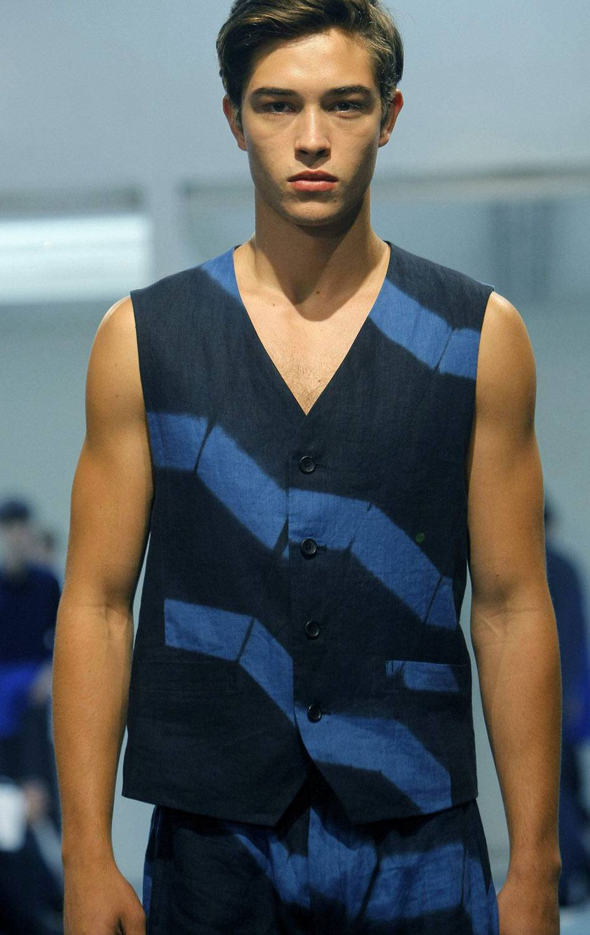 A model wears a creation by Japanese designer Dai Fujiwara for the Issey Miake men's spring-summer 2012 collection, presented in Paris, Thursday, June 23, 2011.