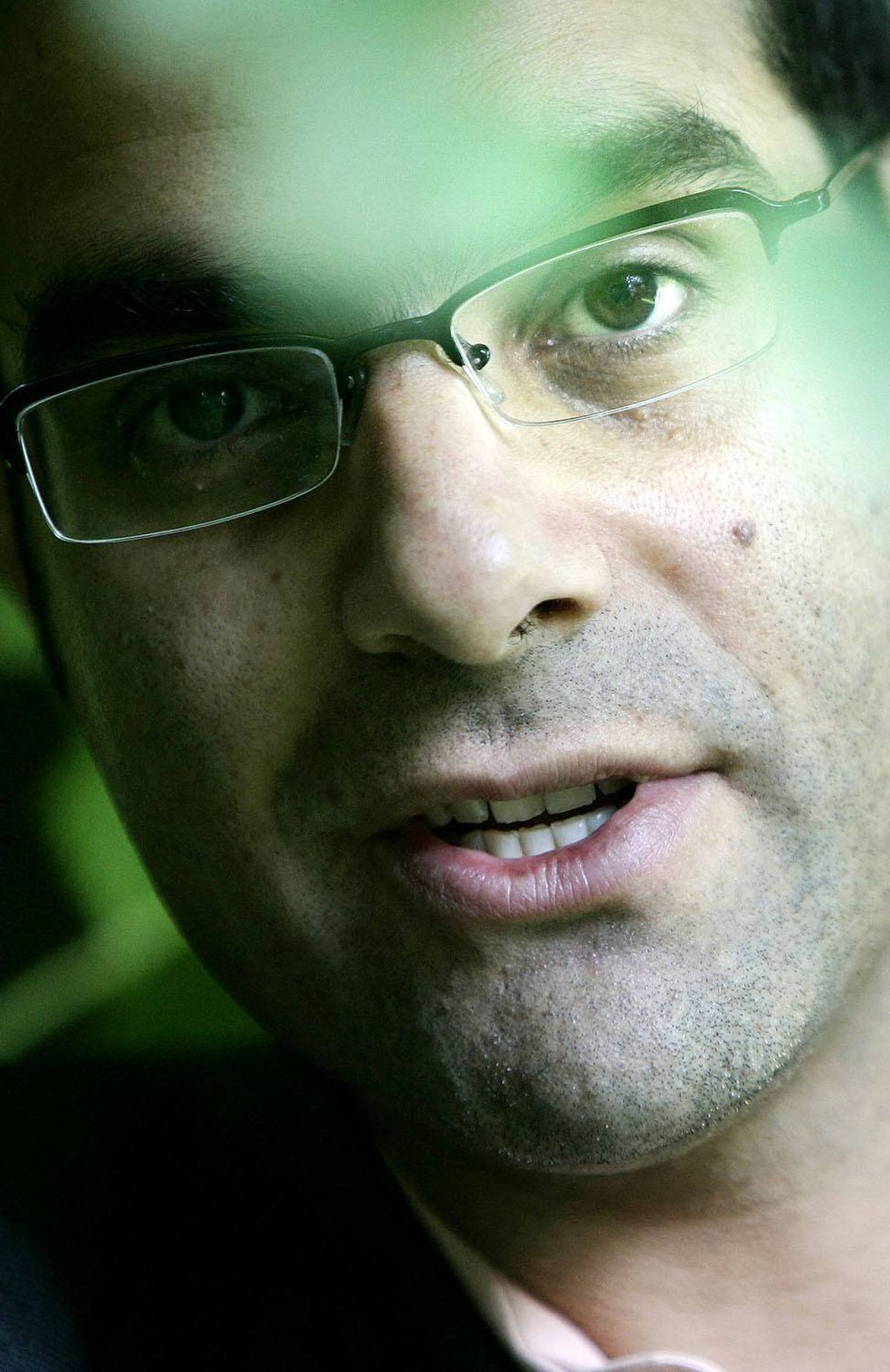 Photo shows malaria researcher Amir Attaran in the garden of his Ottawa home Sept. 22, 2006.