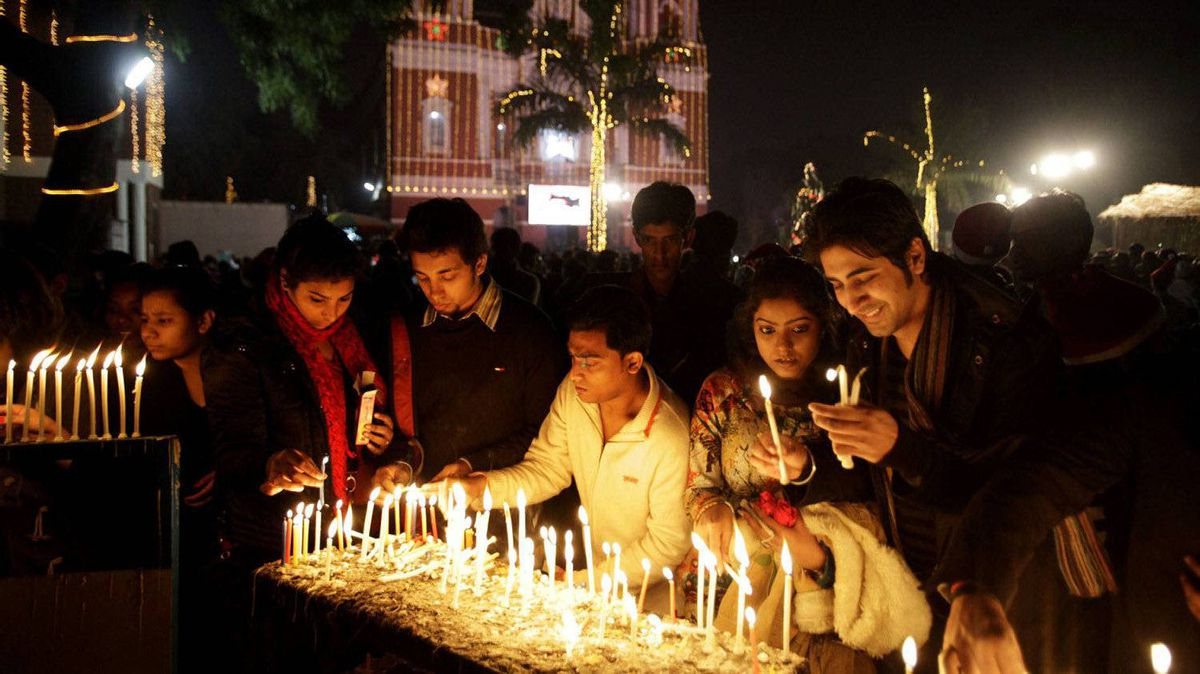 Indians light candles and pray at the illuminated Sacred Heart's Cathedral on Christmas Day, in New Delhi, India, Sunday, Dec. 25, 2011. Christmas is a national holiday in India, marked by millions of all religions and faiths.