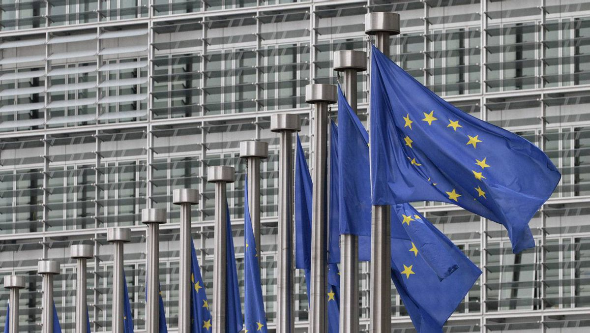 EU flags fly at the European Commission headquarters in Brussels.