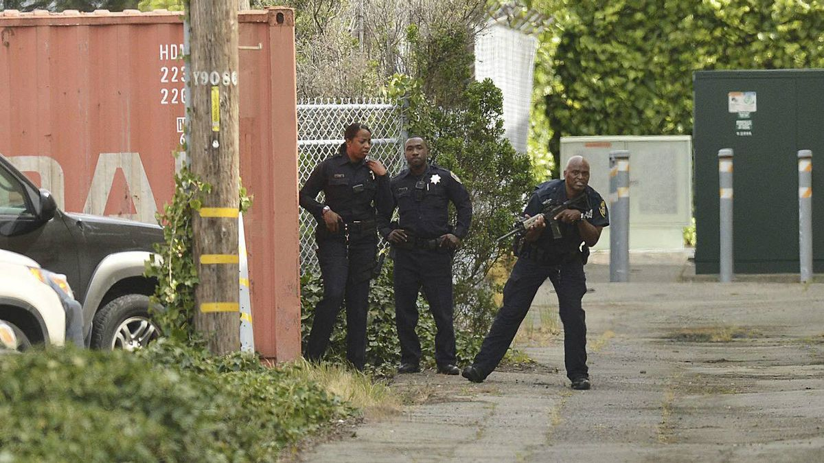 Oakland police officers patrol the area after a school shooting at Oikos University in Oakland, Calif., Monday, April 2, 2012.