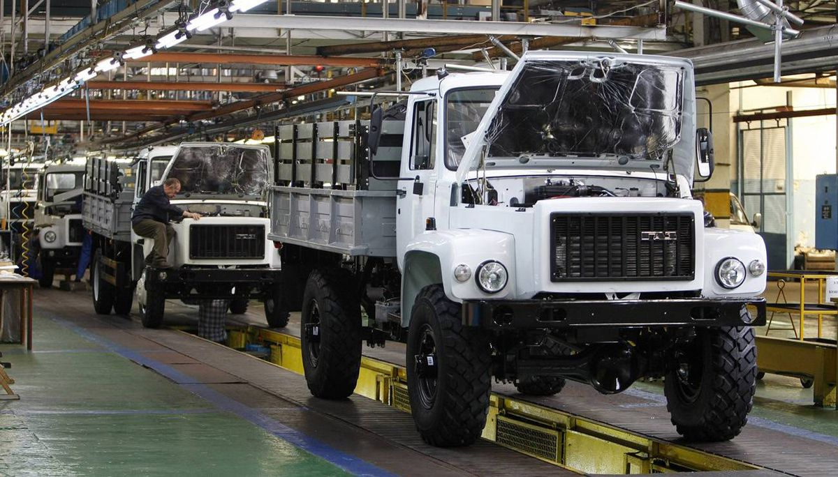 Workers assemble trucks at the GAZ car factory in Nizhny Novgorod. GAZ is the industrial partner in the deal to buy Opel, which Russia hopes will bring in Opel's expertise and a chance of a technical breakthrough in its ailing car industry.