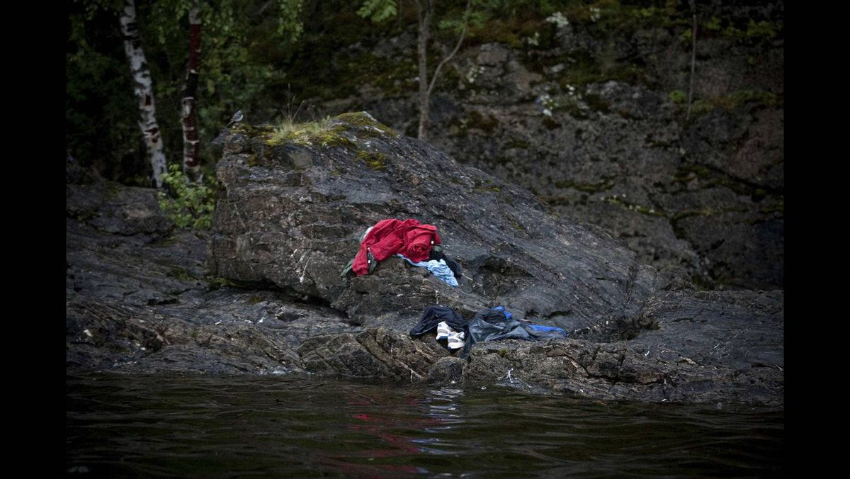 """Niclas Hammerstrom of Sweden, a photographer working for Aftonbladet, has won the second prize Spot News Stories with the series """"Utoya"""".Trying to avoid the killers bullets, many people jumped into the cold water in Utoya, Norway, July 22, 2011. Anders Behring Breivik killed 69 people on 22 July on the small island of Utoya outside Oslo in Norway."""