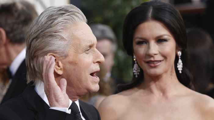 Michael Douglas and Catherine Zeta-Jones arrive at the 68th annual Golden Globe Awards in Beverly Hills, California, in this January 16, 2011 file photograph. Zeta-Jones sought treatment for bipolar disorder after dealing with the stress of husband Douglas's battle with advanced throat cancer, her representative said on April 13, 2011.