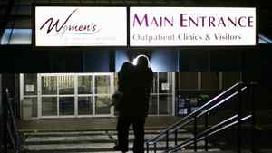 A woman enters B.C. Women's Hospital and Health Centre in Vancouver.