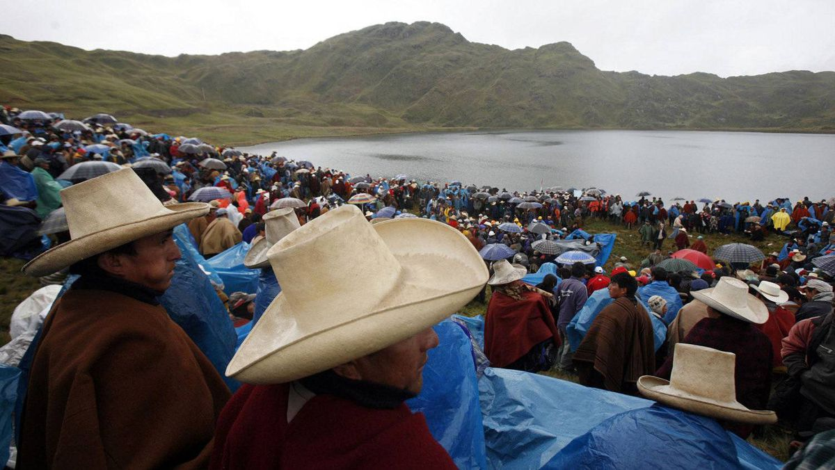 Andean people gather after a march against Newmont's proposed $4.8-billion Conga gold mine, at the El Perol lagoon in the Peruvian region of Cajamarca. Protesters and farmers say the mine would cause pollution and hurt water supplies by replacing a string of alpine lakes with artificial reservoirs.