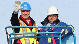 Liberal Leader Michael Ignatieff rides in an aerial lift during a campaign stop at the Det'on Cho Training Centre in Dettah, NWT, on April 18, 2011.