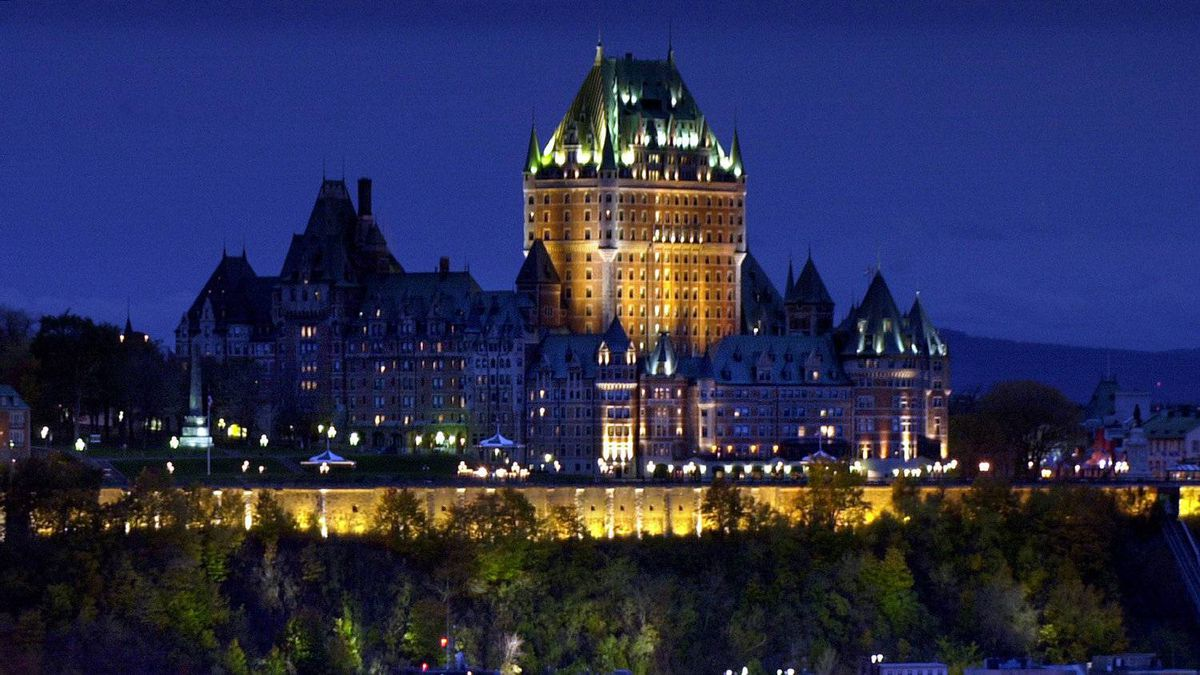 In this file photo from Oct. 23, 2003, the Chateau Frontenac rises above the fortified walls of Quebec City, Quebec.