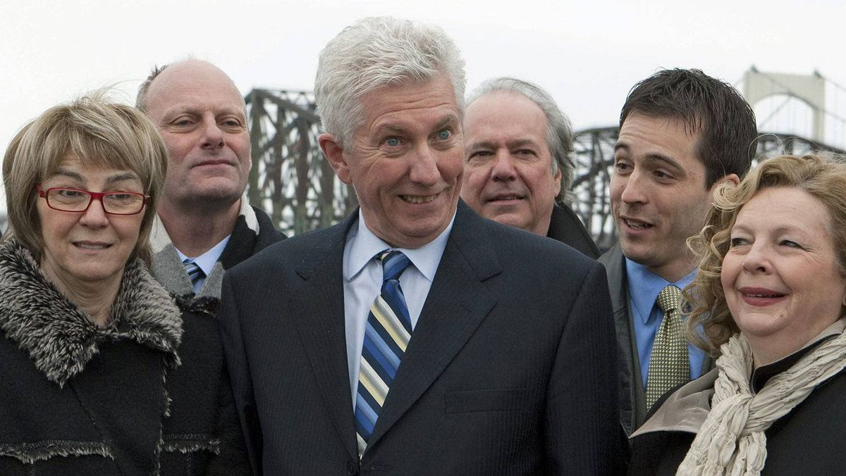 Bloc Quebecois Leader Gilles Duceppe poses with local candidates in Quebec City on April 1, 2011.