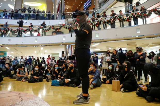 Hong Kong mall protests flare with leader Carrie Lam in Beijing