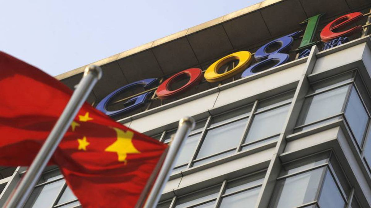 A Chinese flag flies over the company logo outside the Google China headquarters in Beijing on January 14, 2010.