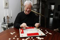 Canadian actor Gordon Pinsent playing scrabble at his home in Toronto.