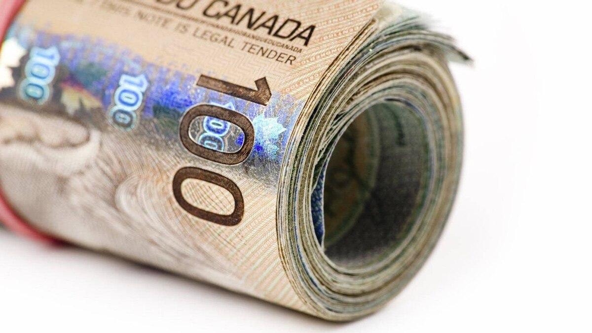 A roll of Canadian bills.