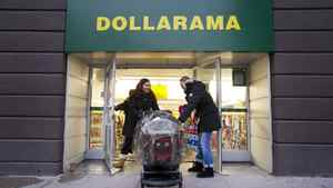 Customers shop at the Dollarama discount store location at Spadina Ave and Adelaide St. West in Toronto, Ont. Dec. 7/2011.