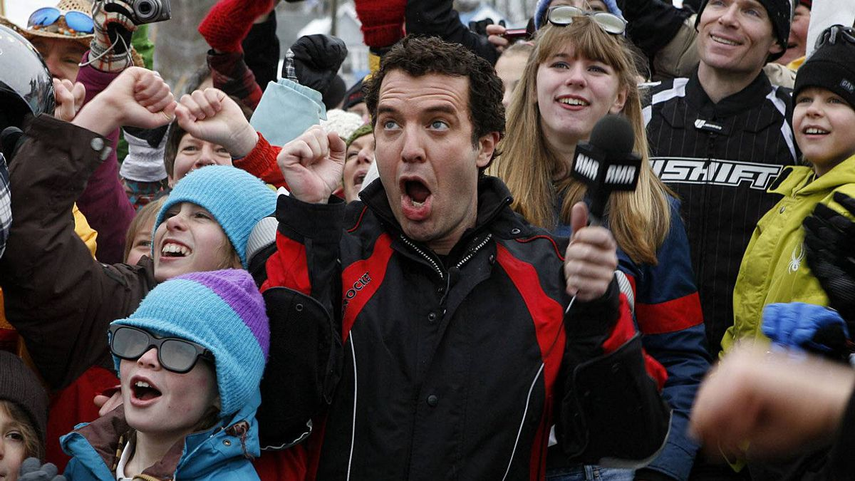 Rick Mercer cheers with the crowd in Rossland, British Columbia, Canada while taping segments for the Rick Mercer Report in 2010.