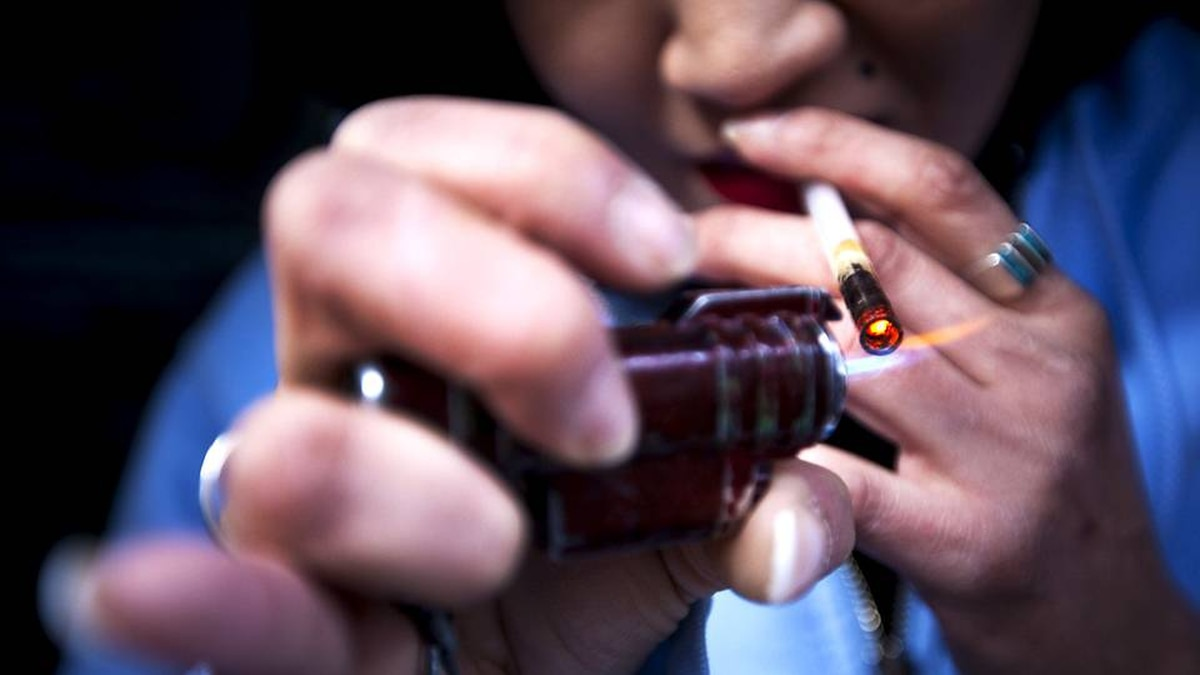 A crack cocaine addict uses a crack pipe to get high in Vancouver's downtown Eastside.