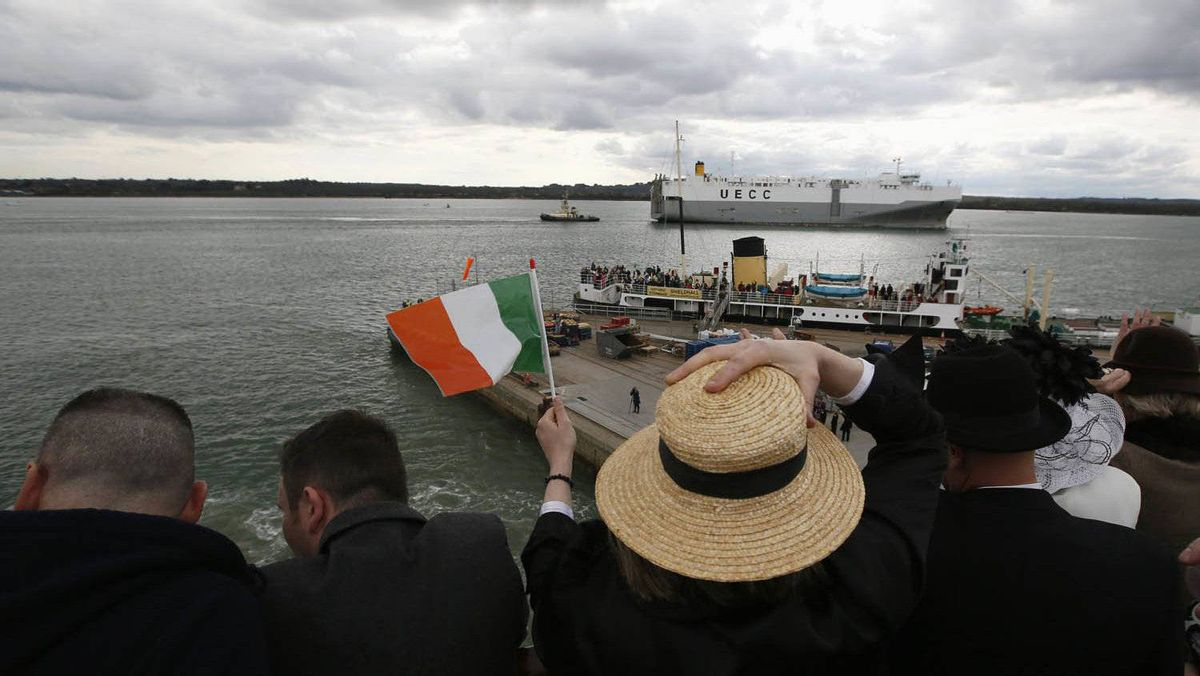 Sharon Sutton of Dublin (C) waves an Irish flag as the Titanic Memorial Cruise leaves port in Southampton, England April 8, 2012.