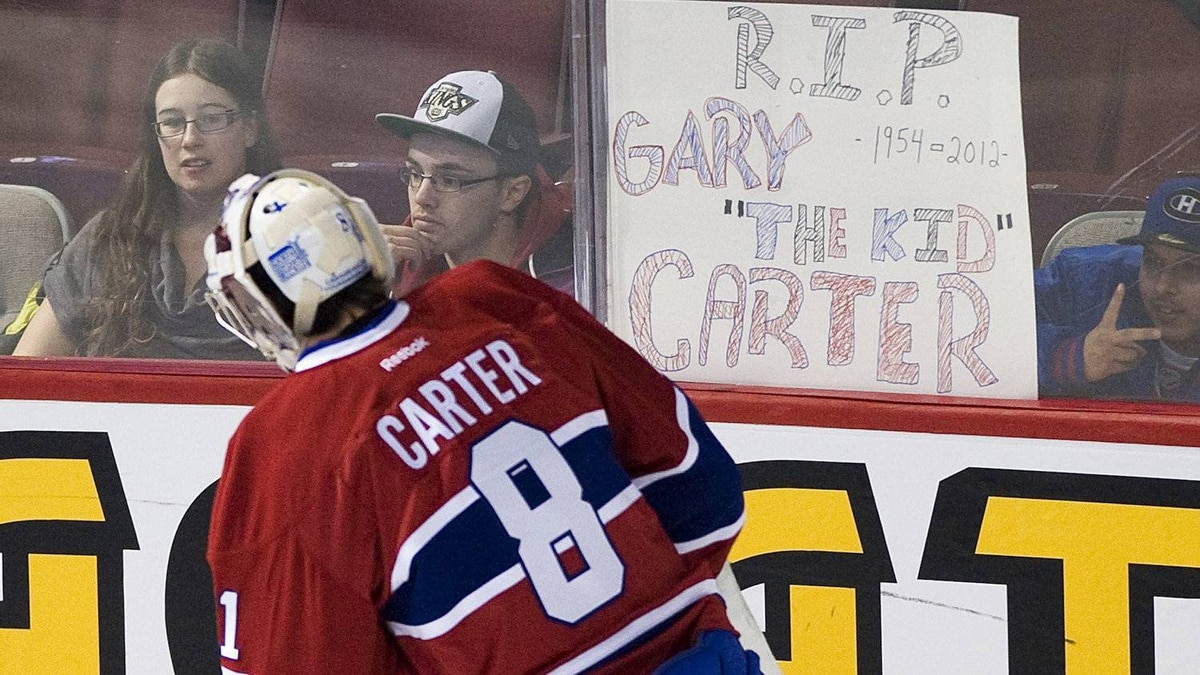 Montreal Canadiens' goaltender Carey Price skates by a sign and wears a jersey im memory of the late Montreal Expos' baseball player Gary Carter prior to an NHL hockey game against the New Jersey Devils in Montreal, Sunday, Februay 19, 2012. THE CANADIAN PRESS/Graham Hughes