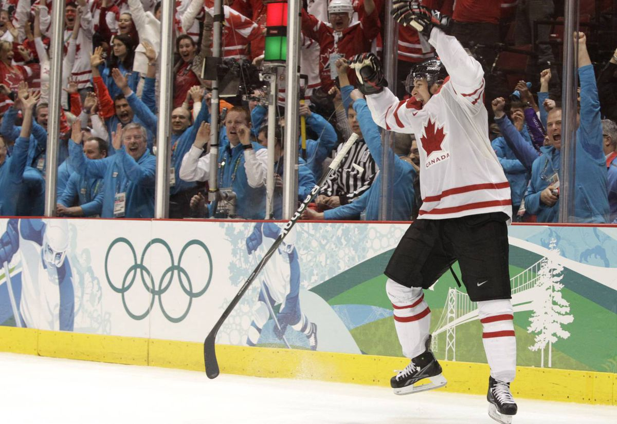 Team Canada's Sidney Crosby tosses his stick in the air while celebrating Canada's 3-2 gold medal overtime win over the United States at Hockey Place in Vancouver on February 28. (Photo by Peter Power / The Globe and Mail)