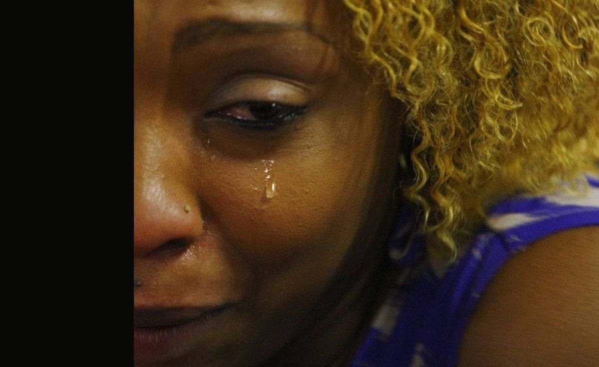 Stone St-Louis, a member Montreal's Haitian community, cries at a Haitian community center in Montreal. St.Louis has not heard from her young daughter who is visiting family in Haiti.