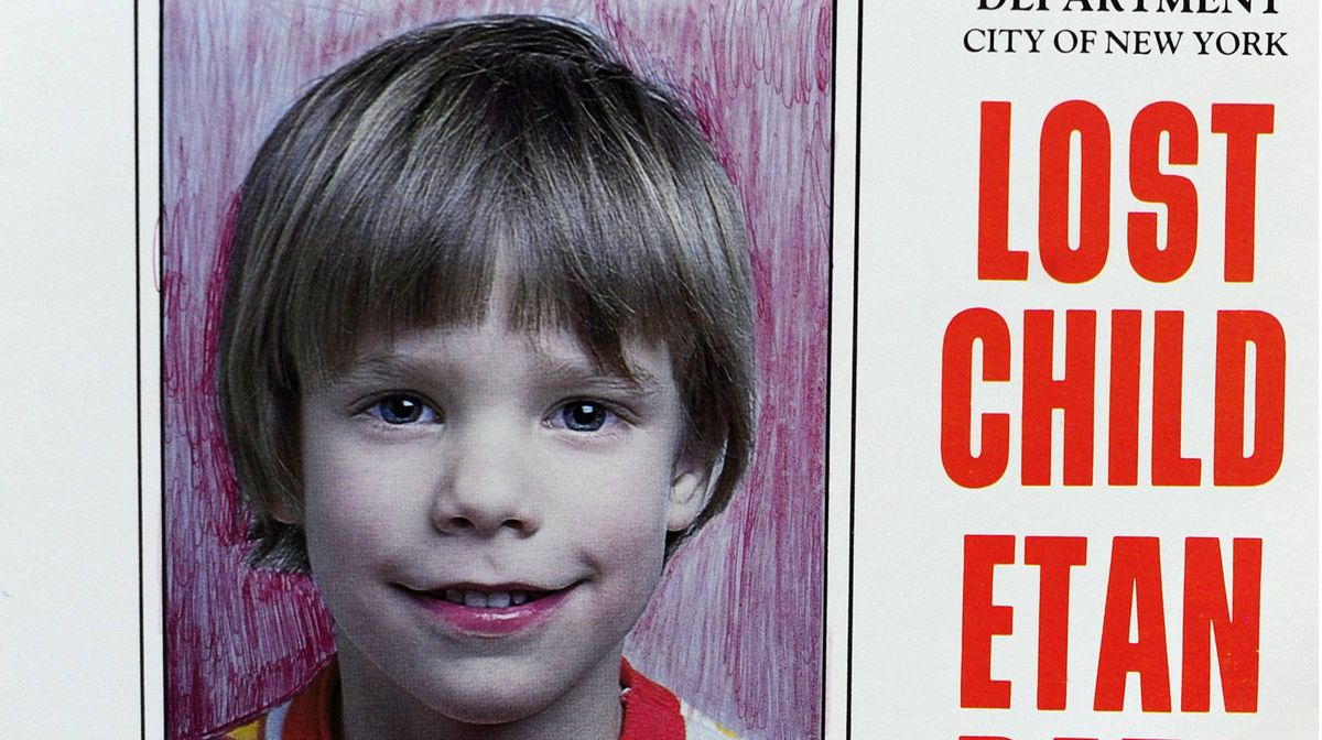 A copy photo of the original missing poster of Etan Patz is shown during a news conference near a New York City apartment building, where police and FBI agents were searching a basement for clues in the boy's 1979 disappearance in New York, April 19, 2012.