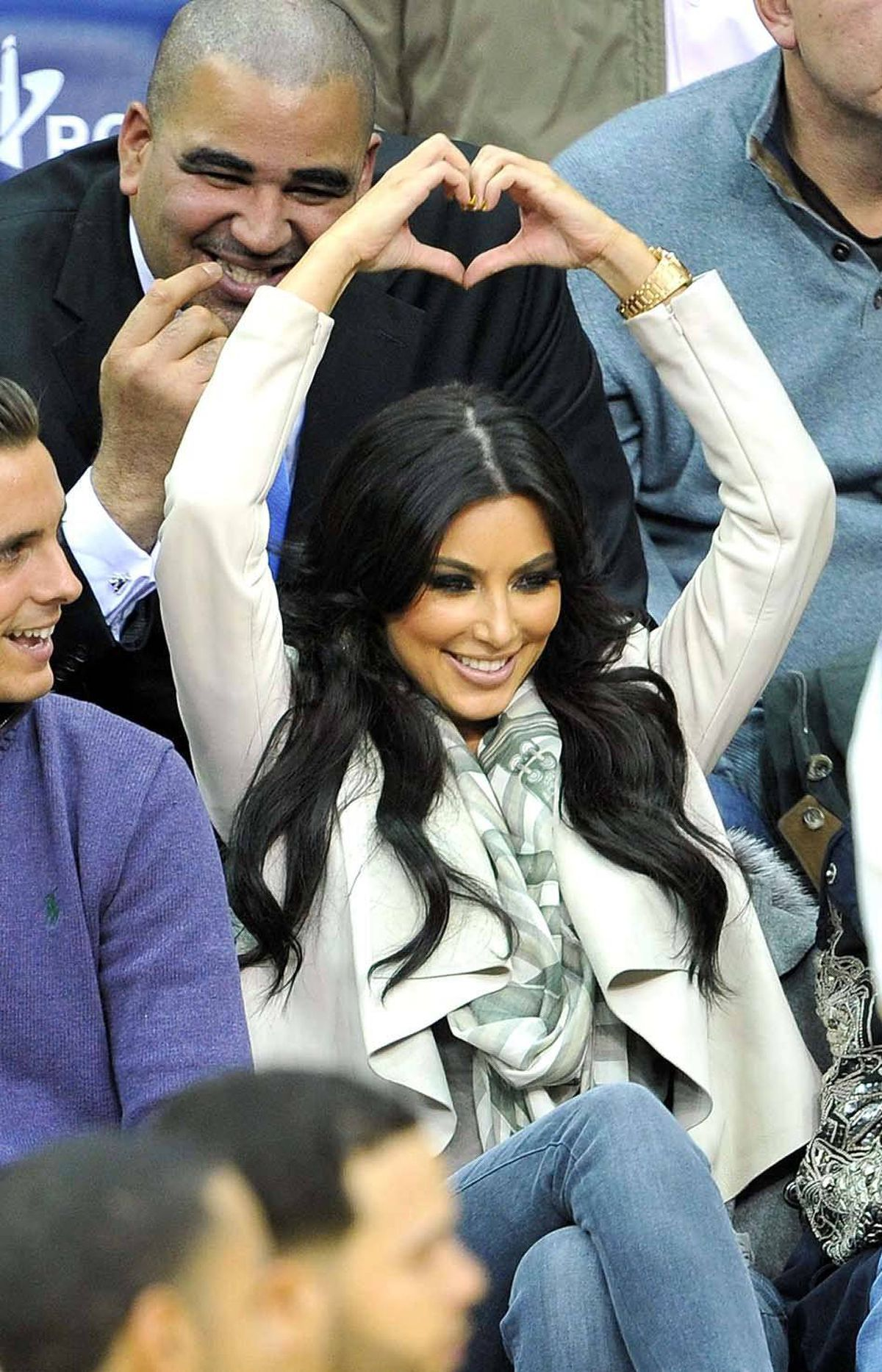 Boy met girl and magic happened, as evidenced here by Kim Kardashian sending completely unembarassing hand signals to Kris Humphries during a New Jersey Nets game in Newark on Jan. 19 of this year.
