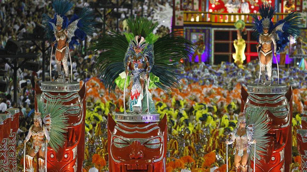 Dancers of Unidos da Tijuca samba school parade on a float during Carnival celebrations at the Sambadrome in Rio de Janeiro, Brazil, Tuesday, Feb. 21, 2012.