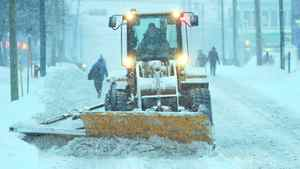 A snow plow operator clears a street in Moncton, New Brunswick Saturday, January 2, 2010. Environment Canada has issued a number of weather warnings for much of Atlantic Canada with heavy snowfall and wind gusts up to 100km/h.