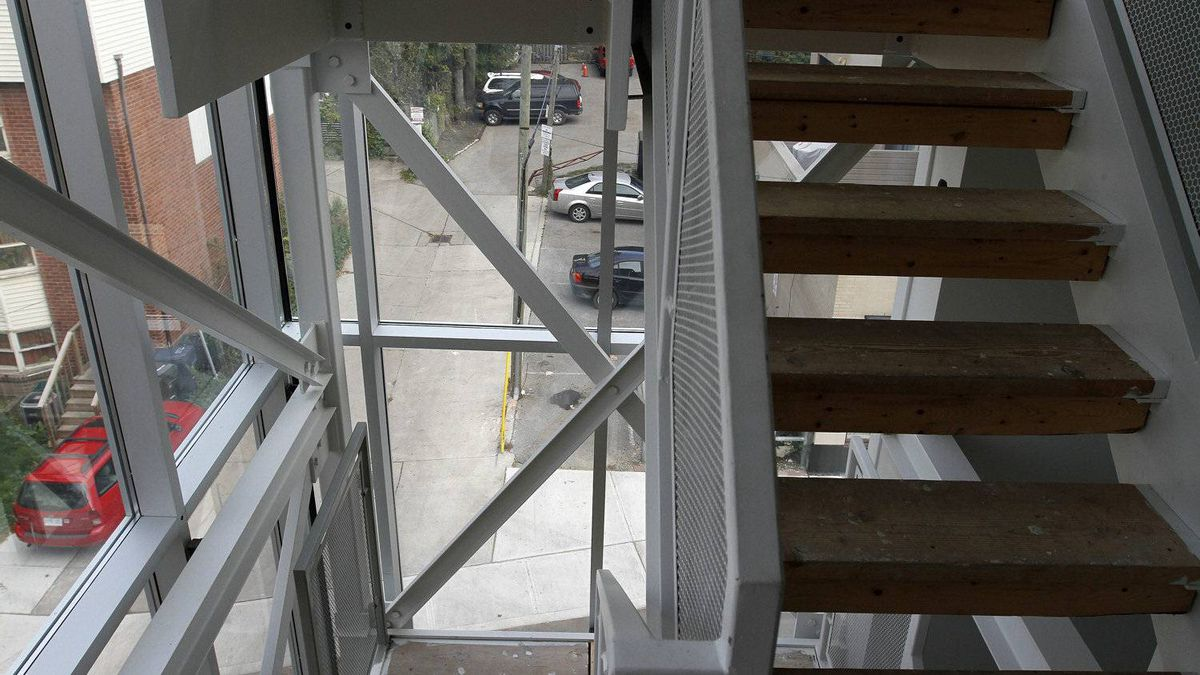 The view out the staircase window is mostly back lots.