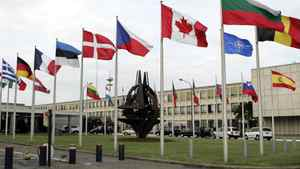 National flags are seen outside NATO headquarters in Brussels.