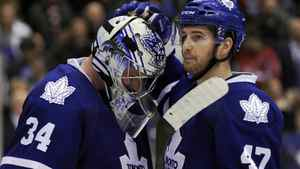 Toronto Maple Leafs goalie James Reimer is consoled by teammate Darryl Boyce (R) after losing to the Washington Capitals during overtime in their NHL hockey game in Toronto April 5, 2011.