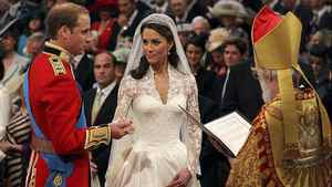 Prince William exchanges rings with his bride Catherine Middleton in front of the Archbishop of Canterbury Rowan Williams inside Westminster Abbey on April 29, 2011 in London, England.