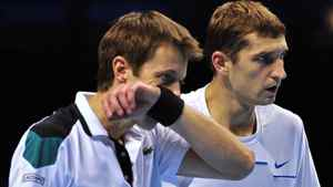 Max Mirnyi of Belarus (R) and his partner Daniel Nestor of Canada (L) talk between points against Nenad Zimonjic of Serbia and his partner Michael Llodra of France during their group B doubles match in the round robin stage on day five of the ATP World Tour Finals tennis tournament in London on November 24, 2011. AFP PHOTO / GLYN KIRK
