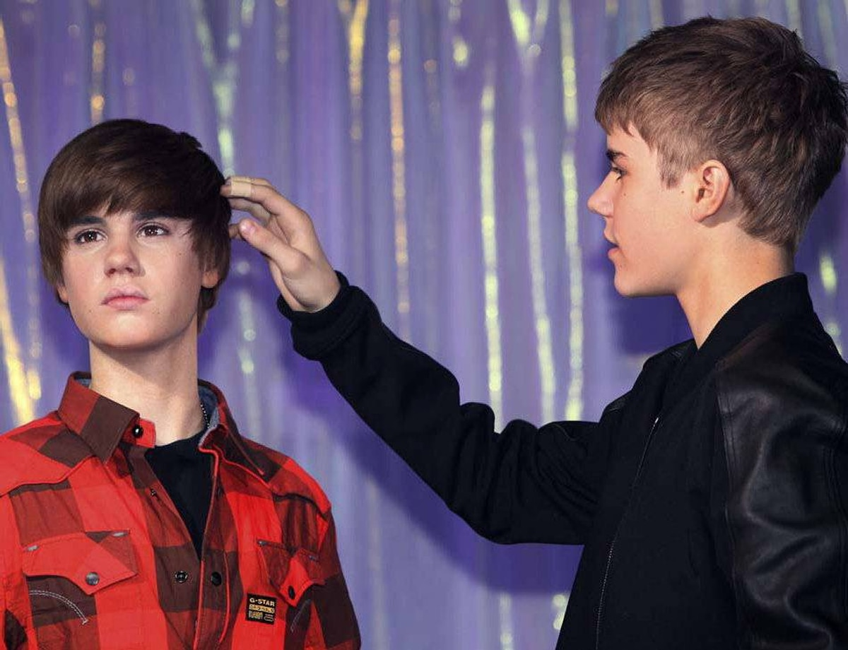 PAGING DR. FREUD. PAGING DR. FREUD Justin Bieber, seen here gently stroking himself at Madame Tussaud's wax museum in London on March 15, was so big in 2011 that even he was in awe of himself. Among his accomplishments: soldout concerts, two Grammy awards and a paternity suit. How many 17-year-olds can say that?! Prediction: The id will continue to rule the ego in 2012. Lawyers will be on standby.