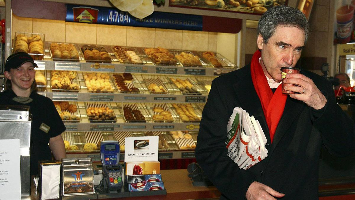 Liberal Leader Michael Ignatieff takes a sip of his coffee at a Tim Hortons in Halifax.