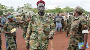 Lord's Resistance Army commander Caesar Achellam, centre, is escorted by members of the Ugandan army on arrival at the army operation base in Nera in South Sudan May 13, 2012 after he was captured by Ugandan soldiers.
