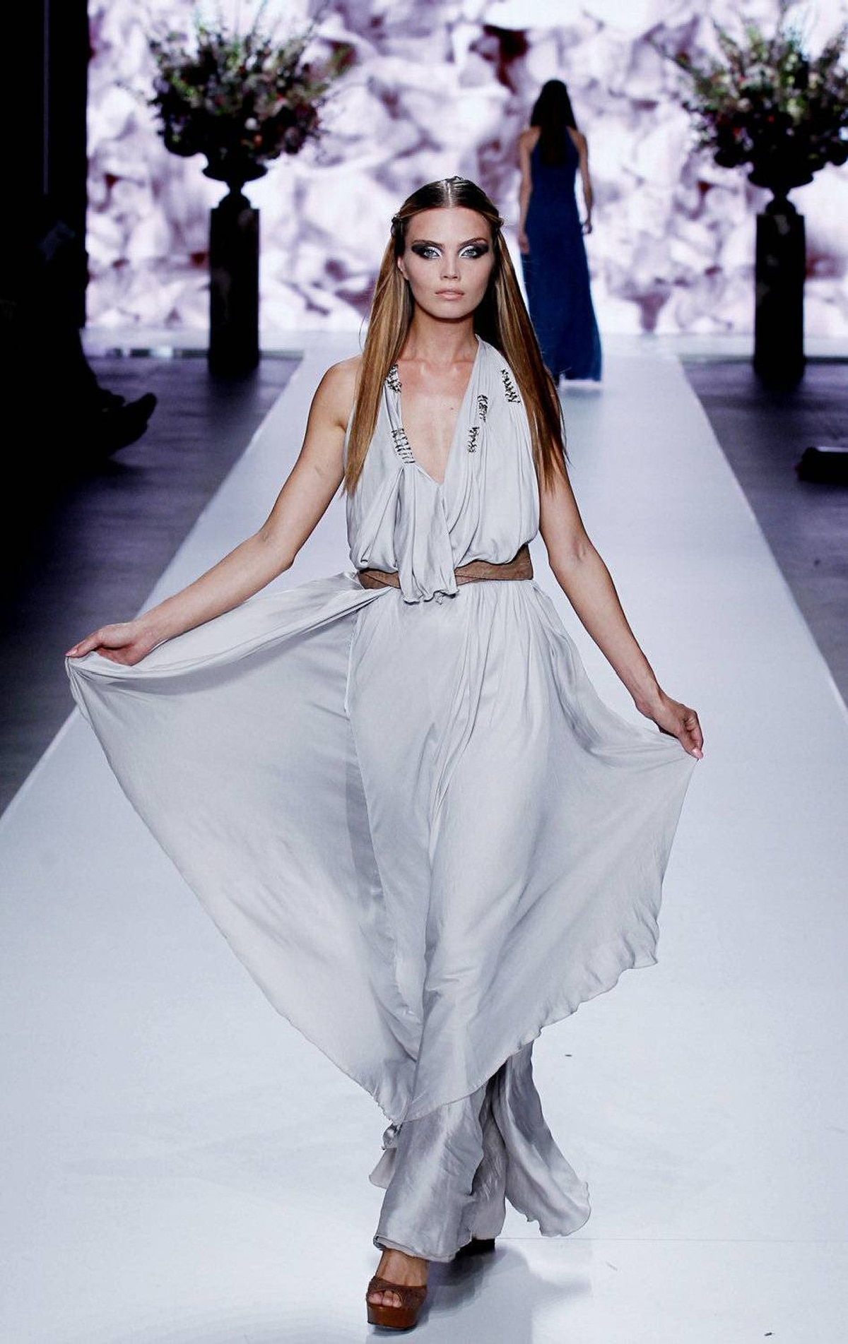 Dutch model Kim Feenstra presents a creation from the collection of designer Tony Cohen, during the opening of the 15th Amsterdam International Fashion Week on July 13, 2011.