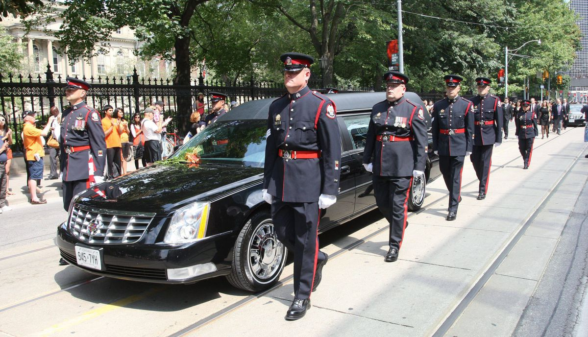 The funeral procession for the late NDP leader Jack Layton leaves City hall for Roy Thomson Hall, in Toronto.
