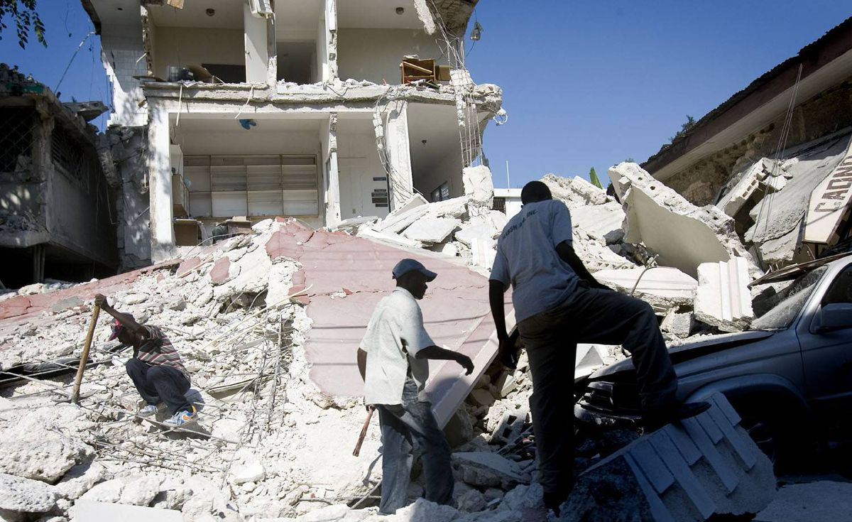 Men dig through the rubble of a collapsed building in downtown Port-au-Prince.