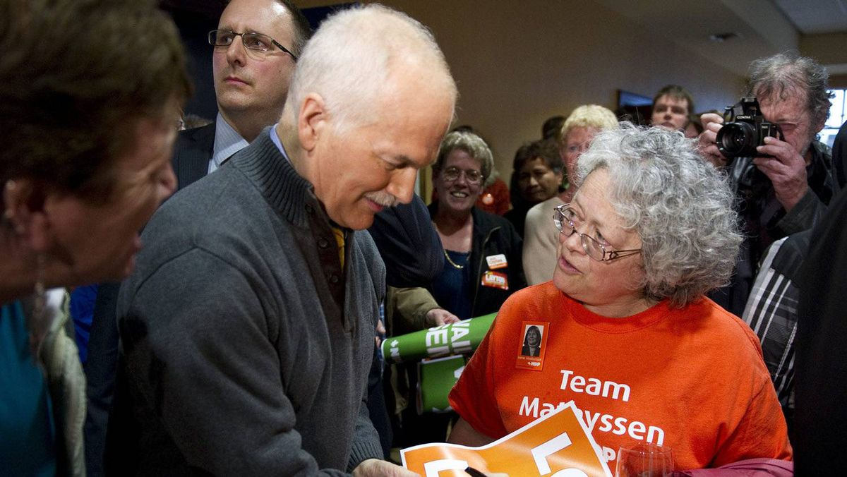 NDP Leader Jack Layton signs an autograph at a rally in London, Ont., on April 4, 2011.