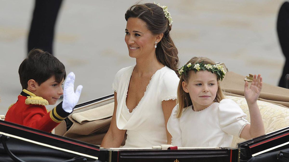 Philippa Middleton, sister of Kate, Duchess of Cambridge, and Maid of Honour travels with a bridesmaid and a page boy in an Ascot Landau carriage along the Processional Route to Buckingham Palace after the wedding ceremony, in London, on April 29, 2011.