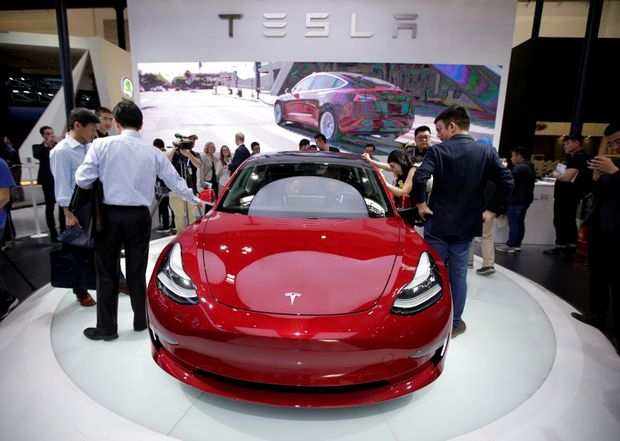 tesla cuts model 3 price again as tax credit is phased out the globe and mail. Black Bedroom Furniture Sets. Home Design Ideas