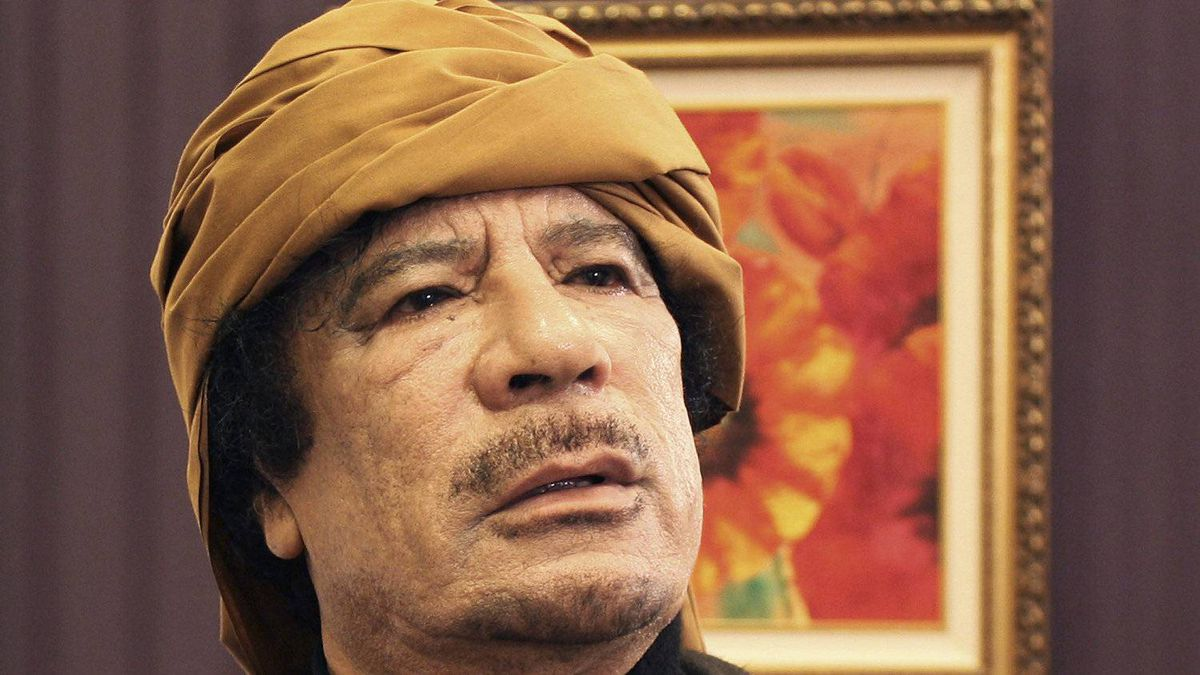 Libya's leader Muammar Gaddafi poses after an interview with TRT Turkish television reporter Mehmet Akif Ersoy at the Rixos hotel in Tripoli March 8, 2011.