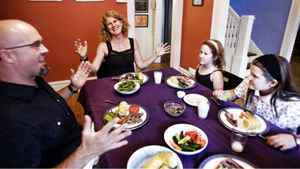 Matt Bonsall and Stephanie Small of Ottawa sit down for dinner with their daughters, Nettie, 7, and Daisy, 10.