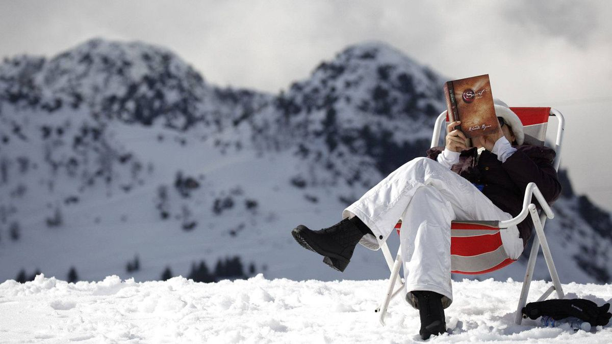 A woman reads a copy of the The Secret at the Laqlouq ski resort.